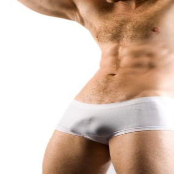 Muscular Male Torso in shorts. On white background