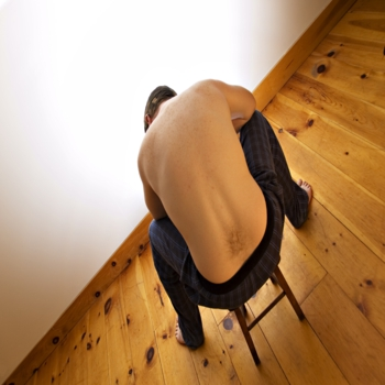 Man thinking in small chair